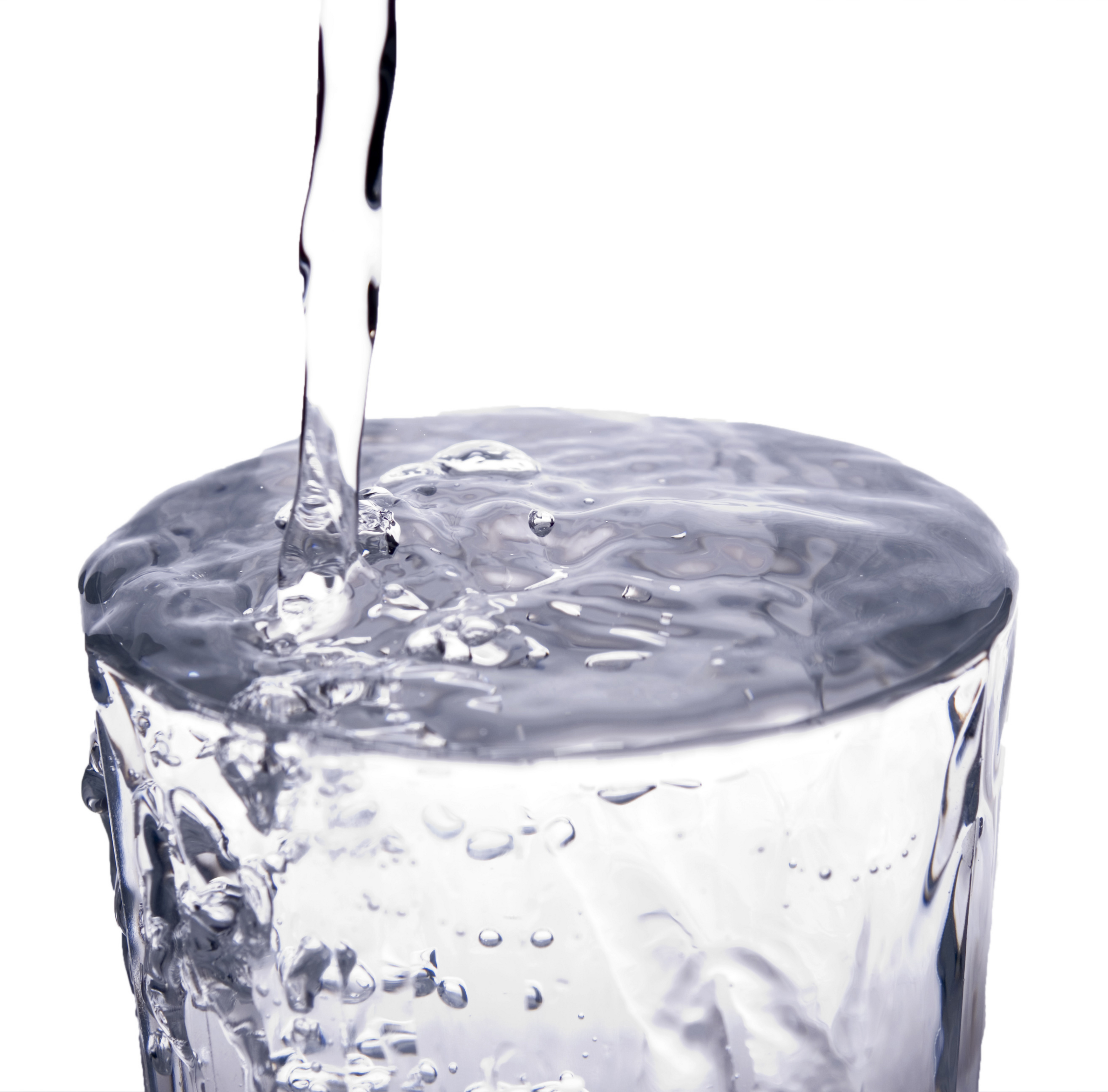 A photo of overflowing glass of water - Canon EOS 400d